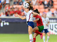 HOUSTON, TX - JUNE 10: Alex Morgan #13 of the United States heads the ball away from Catarina Amado #2 of Portugal during a game between Portugal and USWNT at BBVA Stadium on June 10, 2021 in Houston, Texas.