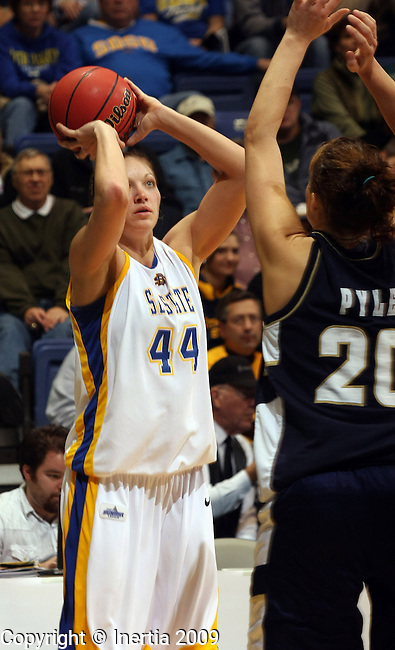 SIOUX FALLS, SD - MARCH 7:  Jennifer Warkenthien #44 South Dakota State University  spots up for a three pointer over Jordan Pyle #20 of Oral Roberts in the second half of their quarterfinal game at the Summit  League Tournament in Sioux Falls Saturday afternoon. (Photo by Dave Eggen/Inertia)