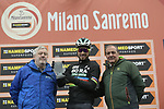 World Champion Peter Sagan (SVK) Bora-Hansgrohe receives a prize awarded by the AIOCC (International Association of Cycling Race Organizers), for his contribution to cycling's international profile at sign on before the start of the 109th edition of Milan-Sanremo 2018 running 294km from Milan to Sanremo, Italy. 17th March 2018.<br /> Picture: LaPresse/Spada | Cyclefile<br /> <br /> <br /> All photos usage must carry mandatory copyright credit (© Cyclefile | LaPresse/Spada)