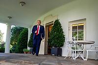 United States President Donald J. Trump walks to the Rose Garden as he holds a press conference at the White House in Washington, DC on Tuesday, July 14, 2020.President Trump talks about Democratic presidential candidate Joe Biden, the stock market and relations with China.<br /> Credit: Tasos Katopodis / Pool via CNP/AdMedia