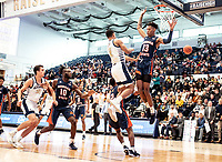 WASHINGTON, DC - NOVEMBER 16: Armel Potter #2 of George Washington makes a pass away from Troy Baxter #13 of Morgan State during a game between Morgan State University and George Washington University at The Smith Center on November 16, 2019 in Washington, DC.