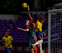 ORLANDO, FL - FEBRUARY 18: Solana Pereyra #1 of Argentina makes a save over Chu #15 of Brazil during a game between Argentina and Brazil at Exploria Stadium on February 18, 2021 in Orlando, Florida.