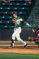 Rony Cabrera (2) of the Greensboro Grasshoppers follows through on his swing against the Hickory Crawdads at L.P. Frans Stadium on May 6, 2015 in Hickory, North Carolina.  The Crawdads defeated the Grasshoppers 1-0.  (Brian Westerholt/Four Seam Images)