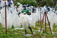 RWANDA, Kigali, plastic recycling at company ecoplastics, worker clean and dry plastic foils before processing to granulate which is used for new plastic products / RUANDA, Kigali, plastic recycling bei Firma Ecoplastics, Sortierung, Reinigung und Trocknung von alten Folien bevor sie zu Granulat recycelt werden
