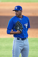 Dunedin Blue Jays relief pitcher Alonzo Gonzalez (21) looks in for the sign during a game against the Clearwater Threshers on April 8, 2016 at Bright House Field in Clearwater, Florida.  Dunedin defeated Clearwater 8-3.  (Mike Janes/Four Seam Images)