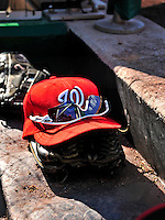 25 September 2010: A Washington Nationals cap, glove and sunglasses rest on the dugout steps during a game against the Atlanta Braves at Nationals Park in Washington, DC. The Braves shut out the Nationals 5-0 to even their 3-game series at one win apiece. The Braves' victory was the 2500th career win for skipper Bobby Cox. Cox will retire at the end of the 2010 season, crowning a 29-year managerial career. Mandatory Credit: Ed Wolfstein Photo