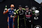 Simon Pagenaud, Team Penske Chevrolet, Scott Dixon, Chip Ganassi Racing Honda, Jack Harvey, Meyer Shank Racing celebrate the win in victory lane on the podium with champagne