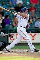 Round Rock Express designated hitter Lance Berkman (12) swings the bat during the Pacific Coast League baseball game against the Salt Lake Bees on August 10, 2013 at the Dell Diamond in Round Rock, Texas. Round Rock defeated Salt Lake 9-6. (Andrew Woolley/Four Seam Images)