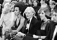 """Andy Warhol (center) and model, actress Donyale Luna (L) at """"Circus of the Stars,"""" (CBS Special), Santa Monica Civic Auditorium, November, 1976. Photo by John G. Zimmerman"""