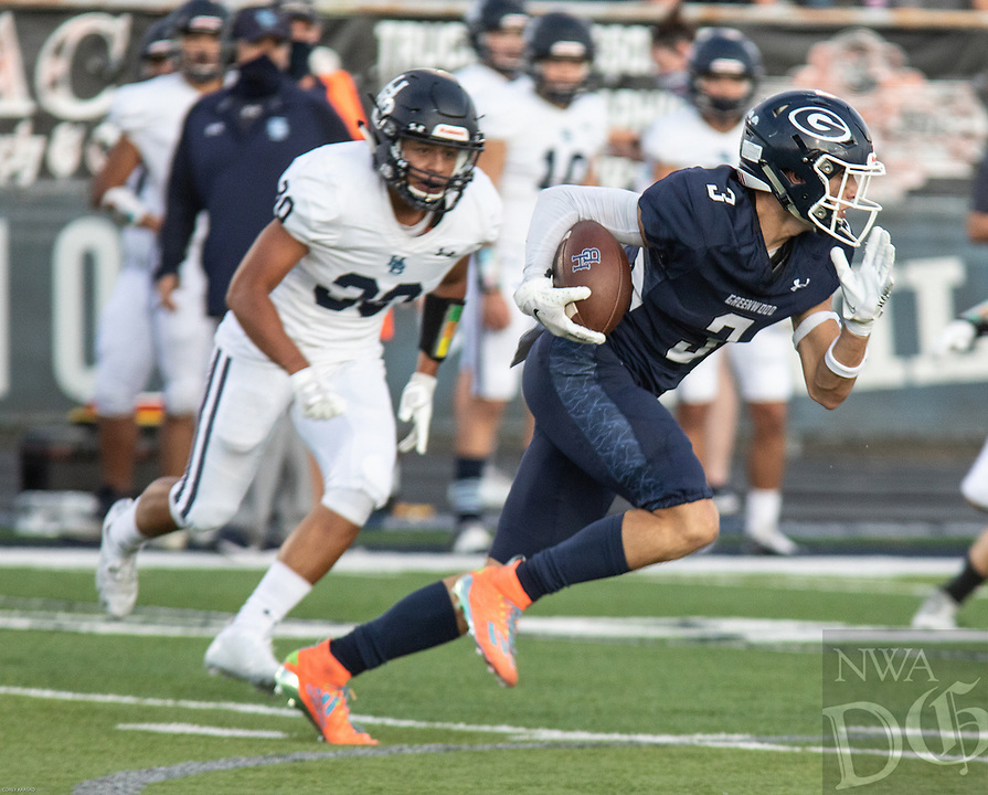 Greenwood's Jayden Jatzen runs with the ball in the first half of Friday's game against Springdale Har-Ber.