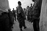 Borzaid, North Darfur, August 23, 2004.An 'Arab' village near Kutum. A group of janjaweed militiamen, commanded by Hafiz, a young man from Mastariha, came to distribute new Khaki uniforms to the village men under the supervision of a Sudanese Police officer (4th from right). .'STOLEN PICTURE'