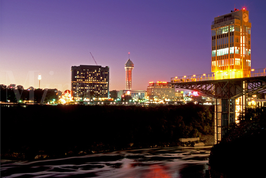 Niagara Falls, New York, NY, Prospect Point Observation Tower at night at Niagara Falls. Ontario, Canada across the Niagara River.