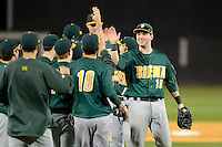 Siena Saints first baseman Larry Balkwill #19 celebrates with teammates after a game against the Central Florida Knights at Jay Bergman Field on February 16, 2013 in Orlando, Florida.  Siena defeated UCF 7-4.  (Mike Janes/Four Seam Images)