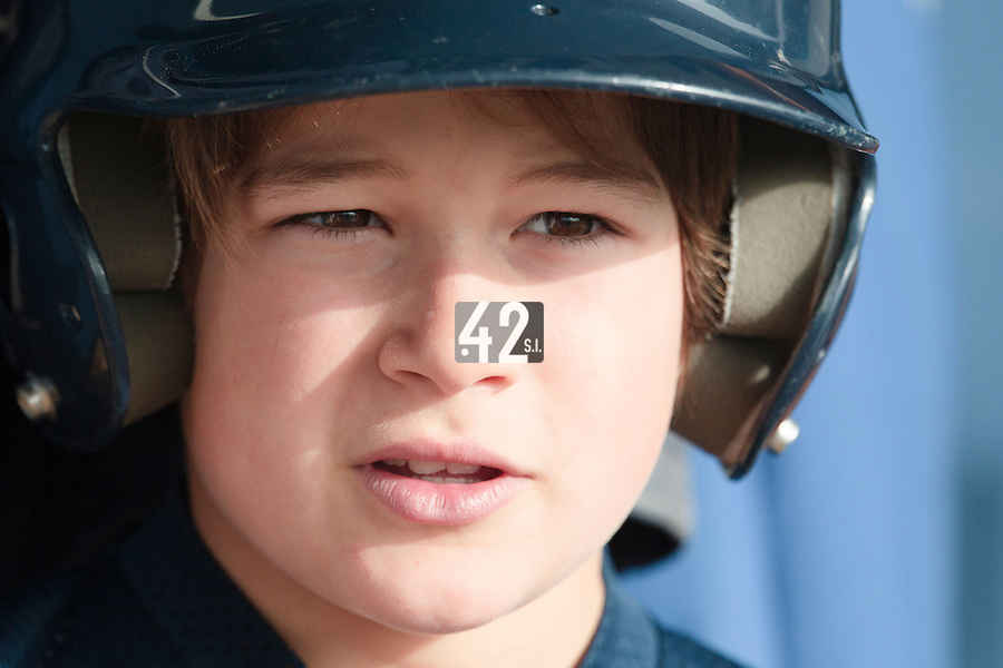 24 October 2010: A bat boy is seen during Savigny 8-7 win (in 12 innings) over Rouen, during game 3 of the French championship finals, in Rouen, France.