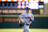 Florida Gators center fielder Jud Fabian (4) jogs off the field between innings of the game against the Tennessee Volunteers on Robert M. Lindsay Field at Lindsey Nelson Stadium on April 9, 2021, in Knoxville, Tennessee. (Danny Parker/Four Seam Images)