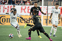 FOXBOROUGH, MA - AUGUST 3: Latif Blessing #7 of Los Angeles FC moves to intercept the ball from Luis Caicedo #27 of New England Revolution during a game between Los Angeles FC and New England Revolution at Gillette Stadium on August 3, 2019 in Foxborough, Massachusetts.