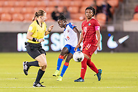 HOUSTON, TX - FEBRUARY 3: Sherly Jeudy #9 of Haiti passes the ball around Marta Cox #11 of Panama during a game between Panama and Haiti at BBVA Stadium on February 3, 2020 in Houston, Texas.