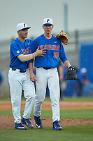 Jonathan India (6) of the Florida Gators tries to calm down starting pitcher Brady Singer (51) as he yells at the TV time-out coordinator during the game against the Wake Forest Demon Deacons during Game Three of the Gainesville Super Regional of the 2017 College World Series at Alfred McKethan Stadium at Perry Field on June 12, 2017 in Gainesville, Florida.  (Brian Westerholt/Four Seam Images)