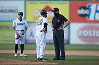 Lynchburg Hillcats manager Dennis Malave (22) discusses a call with umpire Mike Mackey during the game against the Myrtle Beach Pelicans at Bank of the James Stadium on May 23, 2021 in Lynchburg, Virginia. (Brian Westerholt/Four Seam Images)