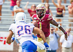Florida State quarterback James Blackman (1) scrambles as Boise State cornerback Avery Williams (26) pursues in the 2nd half of an NCAA college football game in Tallahassee, Fla., Saturday, Aug. 31, 2019. Boise State defeated Florida State 36-31.  (AP Photo/Mark Wallheiser)