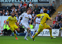Saturday, 06 October 2012<br /> Pictured: Michu of Swansea (C) heads the ball forward while closely marked by Kaspars Gorkss of Reading (R).<br /> Re: Barclays Premier League, Swansea City FC v Reading at the Liberty Stadium, south Wales.