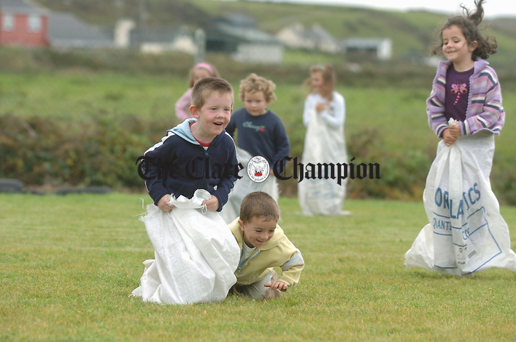 Pupils of Rineen national School take part in the sack racing as part of the festivities to mark  the official opening of their new school Pitch. Photograph by John Kelly.