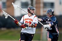 Will Yeatman (23) of Maryland looks to shoot past Tommy Dodge (12) of Penn at Ludwig Field in College Park, Maryland.