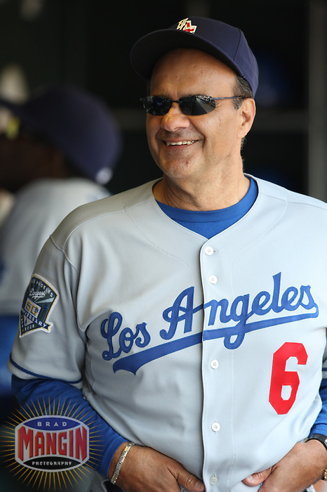 SAN FRANCISCO - JULY 6:  Manager Joe Torre of the Los Angeles Dodgers gets ready in the dugout before the game against the San Francisco Giants at AT&T Park in San Francisco, California on July 6, 2008.  The Dodgers defeated the Giants 5-3.  Photo by Brad Mangin