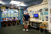 Visitors examine one of the many exhibits at the Pacific Tsunami Museum in downtown Hilo, Big Island of Hawai'i.
