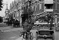 Photo from the NIOD's Huizinga collection. After their surrender, German soldiers leave with horse carts full of advanced equipment, including bicycles.