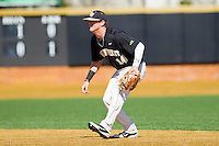 Second baseman Conor Keniry (14) of the Wake Forest Demon Deacons on defense against the Youngstown State Penguins at Wake Forest Baseball Park on February 24, 2013 in Winston-Salem, North Carolina.  The Demon Deacons defeated the Penguins 6-5.  (Brian Westerholt/Four Seam Images)