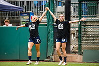 TACOMA, WA - JULY 31: Kelcie Hedge #25 and Leah Pruitt #35 of the OL Reign enter the pitch together during a game between Racing Louisville FC and OL Reign at Cheney Stadium on July 31, 2021 in Tacoma, Washington.