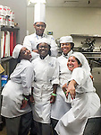 Westside High School culinary students prepare two sandwiches, one of which will be sold at the Super Bowl.