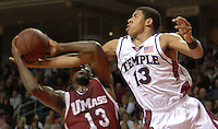 University of Massachusetts forward Stephane Lasme, left, has his drive to the basket stopped by Temple guard Mark Tyndale, right, in second period action Sunday, Feb. 11, 2007 in Philadelphia. Temple beat University of Massachusetts 98-89. (AP Photo/Bradley C Bower)