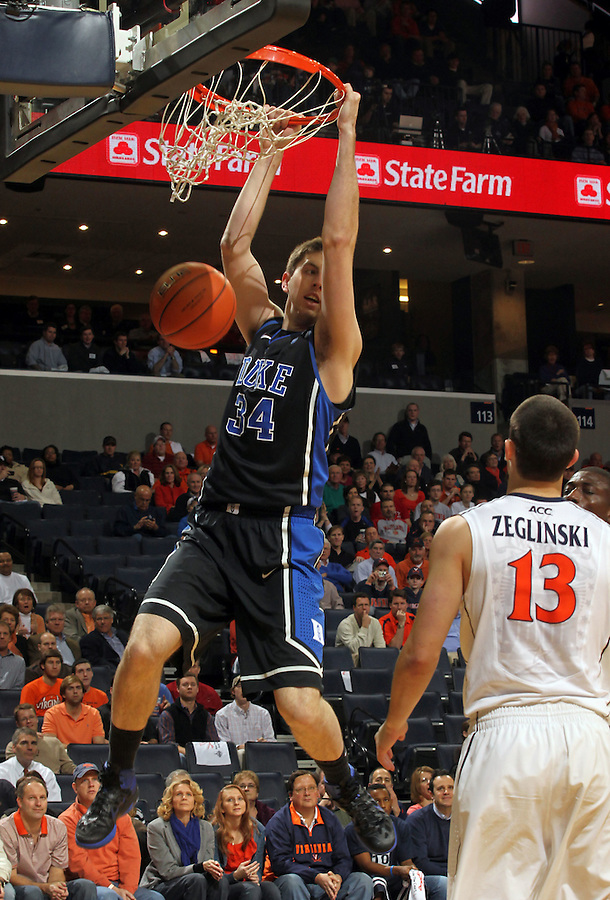 Feb. 16, 2011; Charlottesville, VA, USA; Duke Blue Devils forward Ryan Kelly (34) dunks the ball over Virginia Cavaliers guard Sammy Zeglinski (13) during the first half of the game at the John Paul Jones Arena. Credit Image: © Andrew Shurtleff