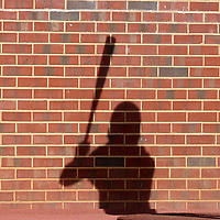CHAPEL HILL, NC - MARCH 08: The evening sun projects the shadow of Dallas Tessar #7 of the University of North Carolina onto the wall behind him in the on deck circle during a game between Notre Dame and North Carolina at Boshamer Stadium on March 08, 2020 in Chapel Hill, North Carolina.
