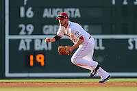 Boston Red Sox shortstop Stephen Drew (7) tracks a ground ball for the Class A Greenville Drive on a tuneup assignment in a game against the Augusta GreenJackets on Friday, May 23, 2014, at Fluor Field at the West End in Greenville, South Carolina. (Tom Priddy/Four Seam Images)