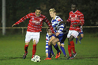 Abs Jariette of Clapton evades Josh Russell of Ilford - Clapton vs Ilford - Essex Senior League Football at the Old Spotted Dog Ground, Upton Park, London - 01/10/13 - MANDATORY CREDIT: Gavin Ellis/TGSPHOTO - Self billing applies where appropriate - 0845 094 6026 - contact@tgsphoto.co.uk - NO UNPAID USE