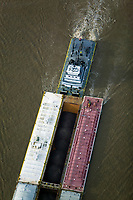 aerial photograph the Robert Greene tug boat pushing barges on the Mississippi at Baton Rouge, Louisiana