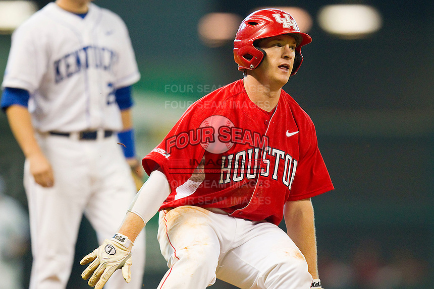 Codey Morehouse #5 of the Houston Cougars puts on the brakes as he rounds third base against the Kentucky Wildcats at Minute Maid Park on March 5, 2011 in Houston, Texas.  Photo by Brian Westerholt / Four Seam Images