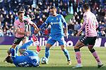 Getafe CF's Nemanja Maksimovic (c) and Real Betis Balompie's Sergio Canales (l) and Antonio Barragan during La Liga match. January 26,2020. (ALTERPHOTOS/Acero)