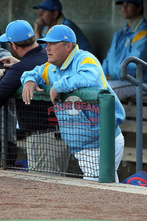 Myrtle Beach Pelicans pitching coach Brad Holman #21 in the dugout during a game against the Frederick Keys at Tickerreturn.com Field at Pelicans Ballpark on April 24, 2012 in Myrtle Beach, South Carolina. Frederick defeated Myrtle Beach by the score of 8-3. (Robert Gurganus/Four Seam Images)