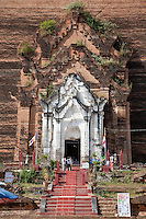 Myanmar, Burma.  Entrance to the Mingun Paya, near Mandalay.  Begun in 1790, this is the base of a pagoda planned to be 500 feet tall.  Construction ended in 1819 when King Bodawpaya died.