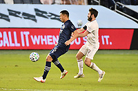 KANSAS CITY, KS - OCTOBER 24: Roger Espinoza #15 of Sporting Kansas City with the ball watched by Jack Price #19 Colorado Rapids  during a game between Colorado Rapids and Sporting Kansas City at Children's Mercy Park on October 24, 2020 in Kansas City, Kansas.