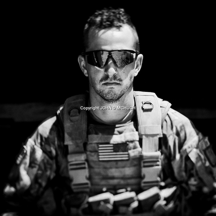 PFC Fulford from 1 Platoon, Delta Co, 1-66, 4th Infantry Division, is seen at Combat Outpost TJ in the Arghandab Valley, Kandahar, 03 May 2011. (John D McHugh)