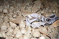 Miniature mani stones and stupas made of clay, lay inside a large stupa, Khumbu, Nepal