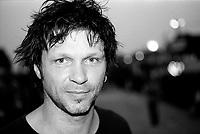 Bertrand Cantat, portrait,<br />DETROIT  ex  noir desir<br /> canon eos1n, kodak Trix400, canon 24-70mm 2.8 L<br />Portrait<br />Eurockéennes Belfort <br />2012<br />© kevin Pailler  / DALLE