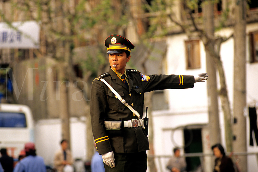 Police directing traffic in Beijing China.