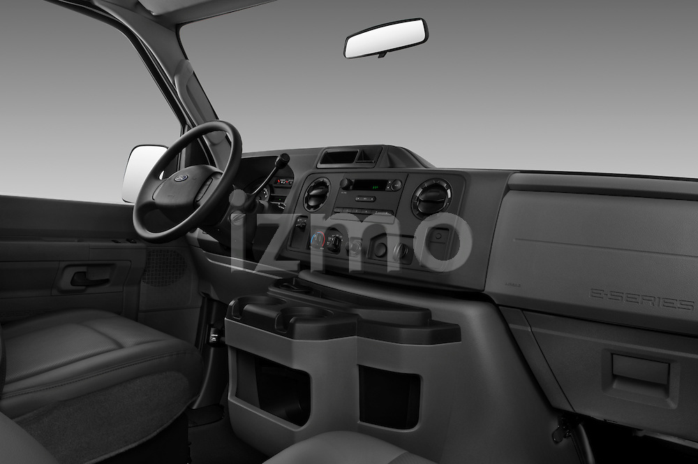 Passenger side dashboard view of a 2009 Ford E 150 Cargovan.