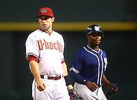 May 8, 2015; Phoenix, AZ, USA; Arizona Diamondbacks first baseman Paul Goldschmidt (left) and San Diego Padres outfielder Justin Upton at Chase Field. Mandatory Credit: Mark J. Rebilas-USA TODAY Sports